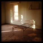 A rusty bed on the 2nd floor