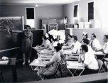 P 55, 1963 Nov 13, Nurses Training School over No 2 Fe Dining Room, Sr Phyl Wilson instructing
